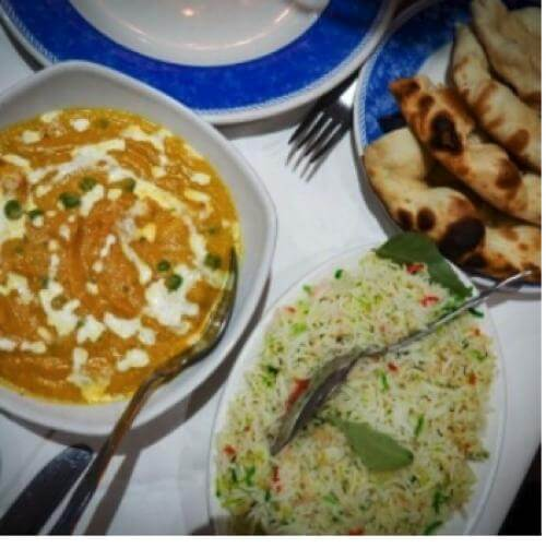 butter-chicken-dish-with-rice-and-garlic-nan