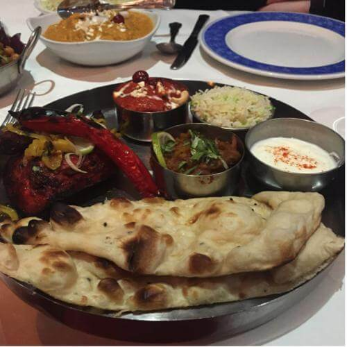 meat-thali-with-curries-in-background